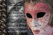 Venetian carnival mask with music score and flute poster