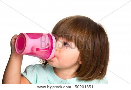 Portrait Of A Cute Drinking Little Toddler Girl