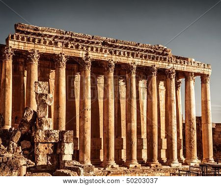 Jupiter's temple ancient Roman columns, Baalbek, Lebanon, aged arabic castle, world famous landmark, historical monument, travel concept poster