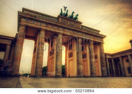 Brandenburg Gate. German Brandenburger Tor in Berlin, Germany. Sunset with beautiful sunbeams