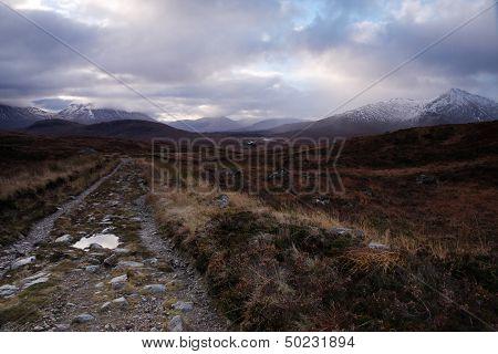 Moorland track leading to distant hills on Rannoch Moor near Glencoe, Scottish Highlands poster