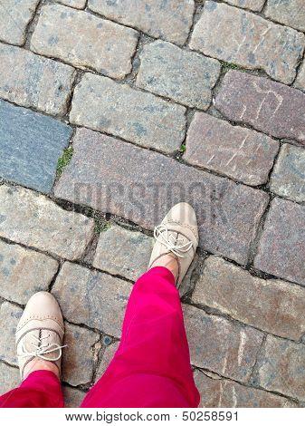 Woman walking on stone pavement