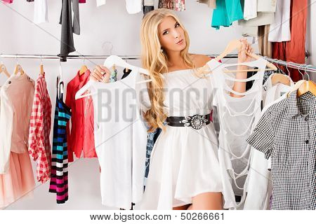 Fashionable young woman shopping in a clothing store.