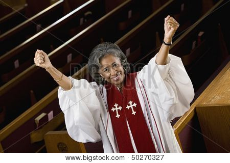 Portrait of female Reverend cheering