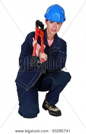 Craftswoman holding a spanner