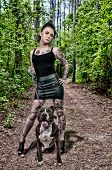 Beautiful young woman with her pit bull dog poster