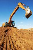 loader excavator machine doing earthmoving work at sand quarry poster