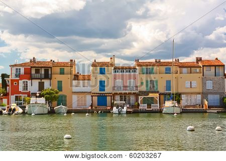 Yachts and houses in Port Grimaud, France poster