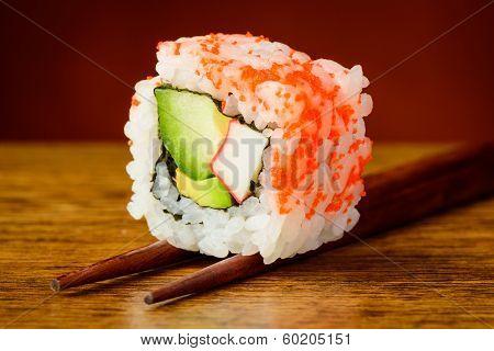 Uramaki Sushi Closeup On Chopsticks