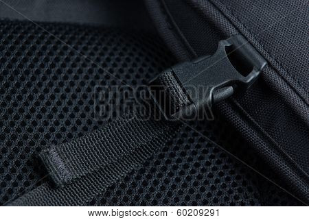 Black plastic buckle on backpack