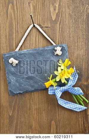 Little Slate Board And Fresh Daffodils