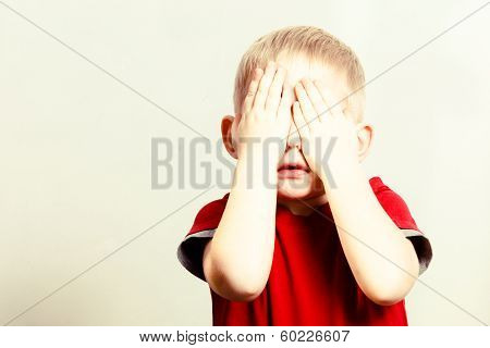 Happy Childhood. Blond Boy Child Kid Covering Face With Hands