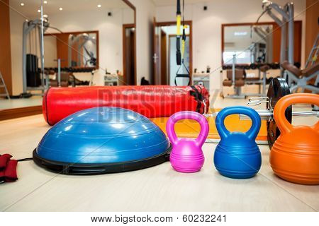 Kettlebells at fitness gym with stepper