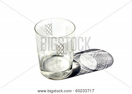 Decorated clear glass with shadow isolated on white