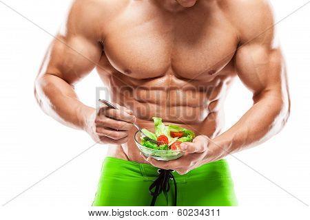 Fit Man Holding A Fresh Salad Bowl