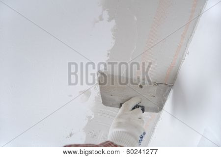 Contractor plastering a ceiling using plaster net poster