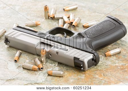 Handgun Surrounded With Scattered Bullets