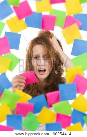 Stressed Womam With Note Surrounded By Papers