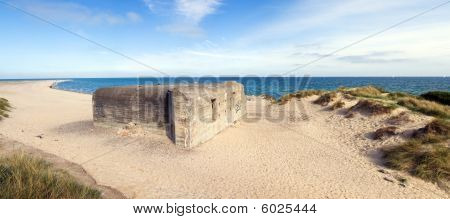 German War Bunker On Beach By Sea