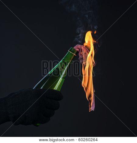 molotov cocktail in activist hand