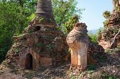 Ruins of lion statue in ancient Burmese Buddhist pagodas Nyaung Ohak in the village of Indein on Inlay Lake in Shan State Myanmar (Burma). poster