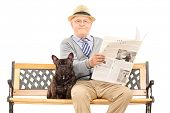 Senior gentleman sitting on a bench with his dog and reading a newspaper, isolated on white background. poster