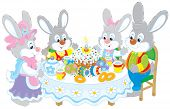 Family of rabbits celebrating Easter at the holiday table with a fancy holiday cake and colorfully painted eggs poster