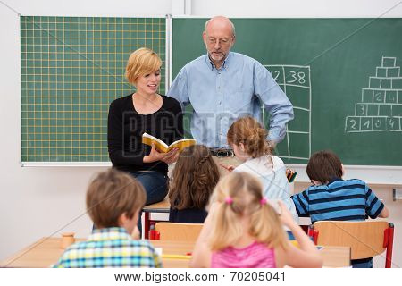 Teacher With His Teaching Assistant