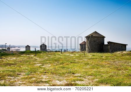 Traditional Windmills By The Apulia Beach