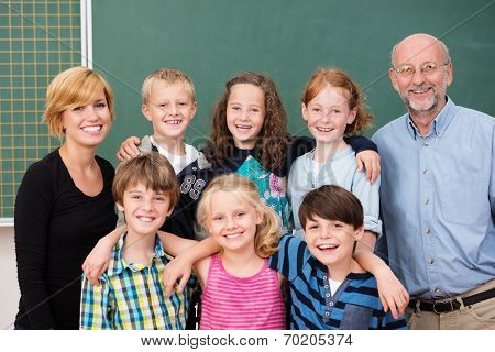 Class Of Young Students Posing With Their Teachers
