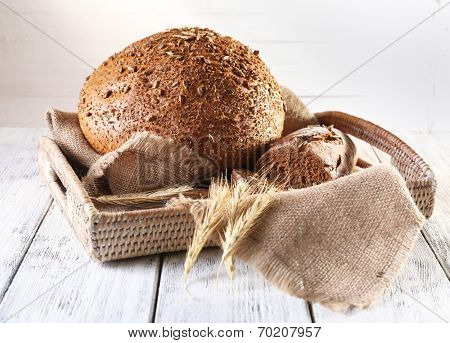Fresh bread on wooden table, close up