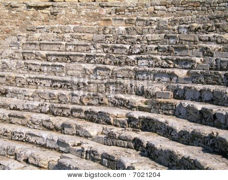 Steps and seets in a Greek amphitheater in Segesta, Sicily poster