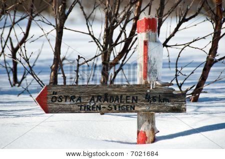 Wintery Signpost In Sweden