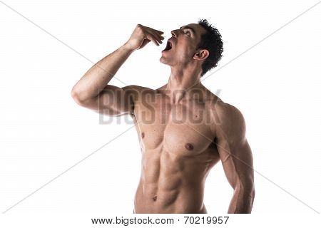 Strong Muscular Man Taking Diet Supplements