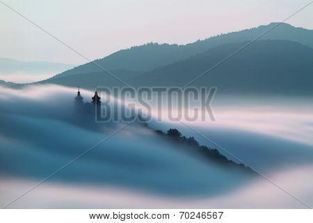 Calvary over clouds in Banska Stiavnica, Slovakia