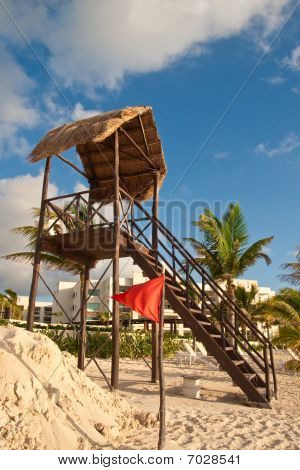 Red Warning Flag By Sandpile And Lifeguard Stand