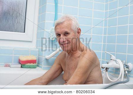 Happy Senior Man In Bath