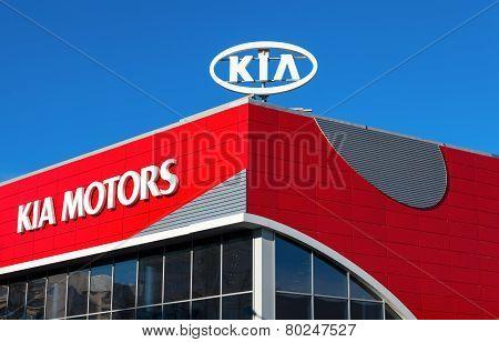 The Emblem Kia Motors On Blue Sky Background