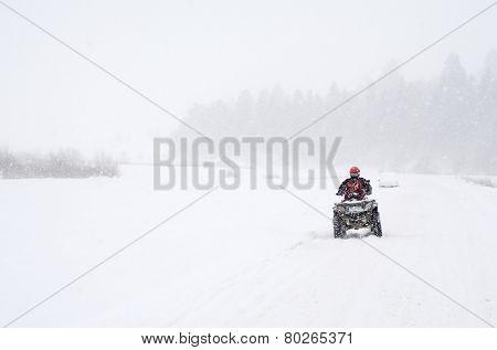 ATV on a snowy road