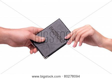 hand giving passport to other person