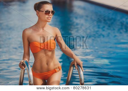 Portrait of a beautiful woman by the pool.