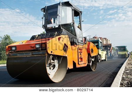 Vibration Compactor At Asphalt Pavement Works (wide Angle)