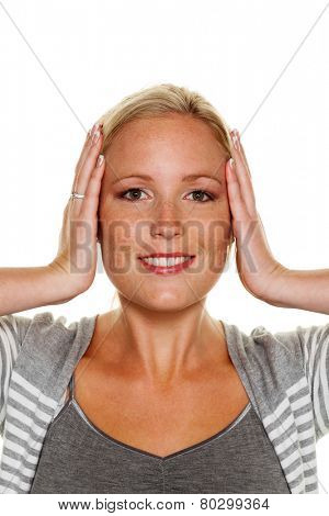 a young woman holds her ears. symbolic photo for not want to hear disputes and conflicts, as well as loud undtinnitus poster