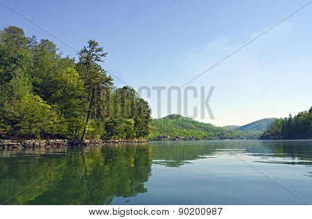 Springtime On A Lake With Distant View Of The Mountains.