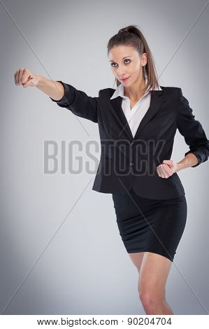 Powerful Business Woman Pulling A Punch