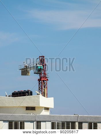 Setting Up A Tower Crane In The Construction Site