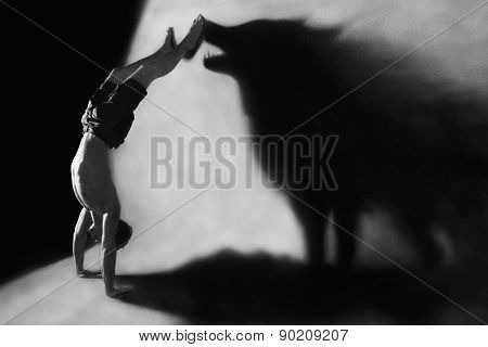 Handstand With Wolf Silhouette