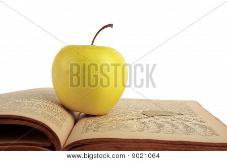 Apple And Old Book