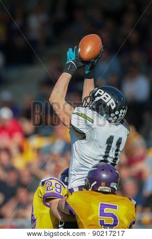 VIENNA, AUSTRIA - APRIL 27, 2014: WR Jan Dundacek (#11 Panthers) catches the ball.