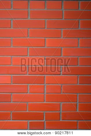 The red brick wall background. Vertical view.